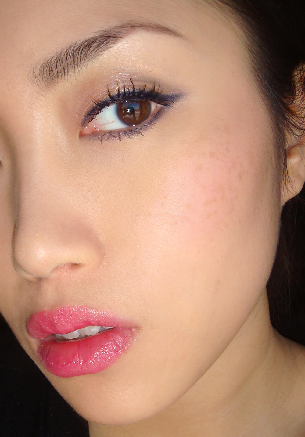 Wearing Pixi Succulent Lip Twin in Pink Peony and Endless Silky Eye Pen in Blue Black