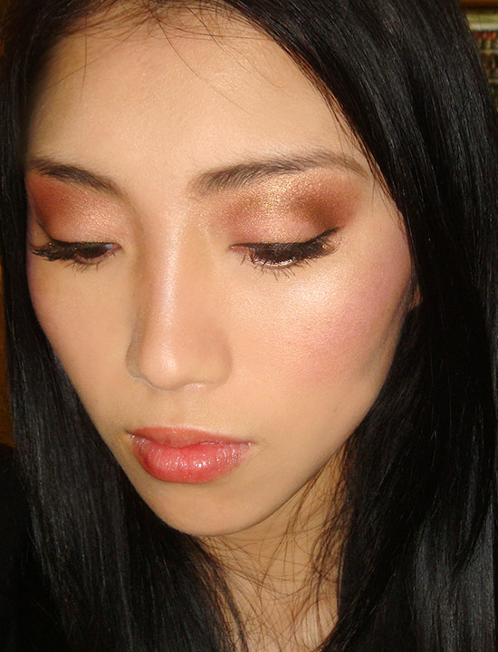 Metallic gold eye makeup with contoured cheeks
