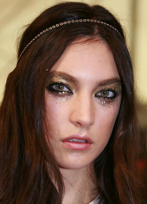 Smudgy glitter glam rock makeup at DSquared2 Spring/Summer 2012