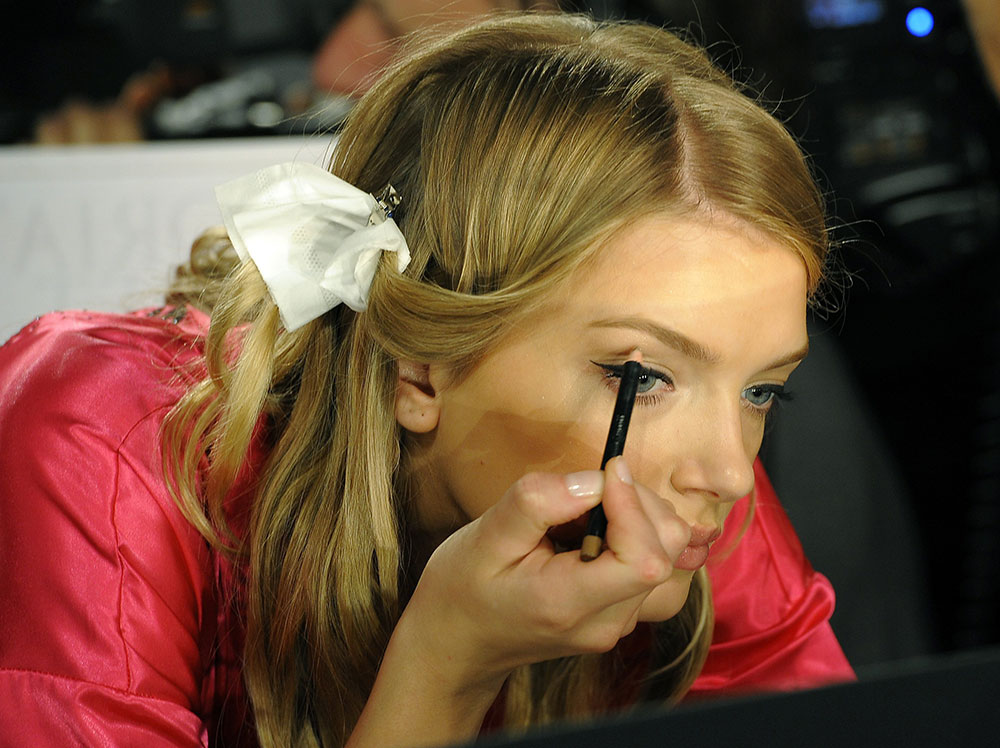 Lily Donaldson doing makeup at Victoria's Secret 2011 Fashion Show Backstage