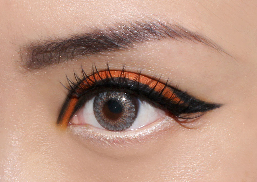 Graphic Orange Eye face of the day