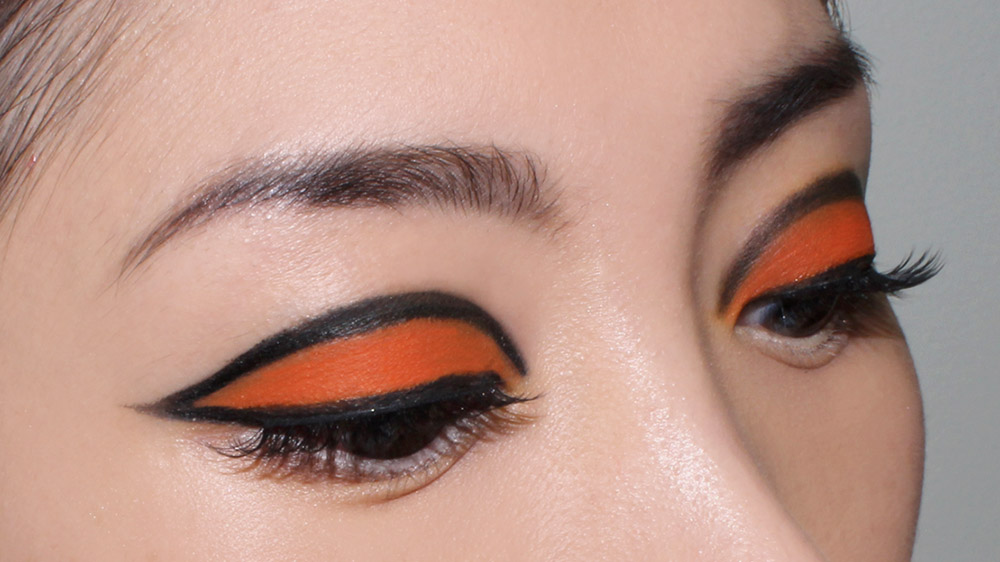 Graphic Orange Eye and Nude Lips Makeup Look