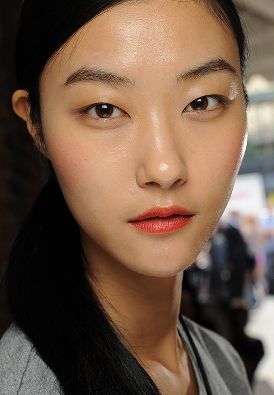 Flawless skin and orange lips at DKNY S/S 2014