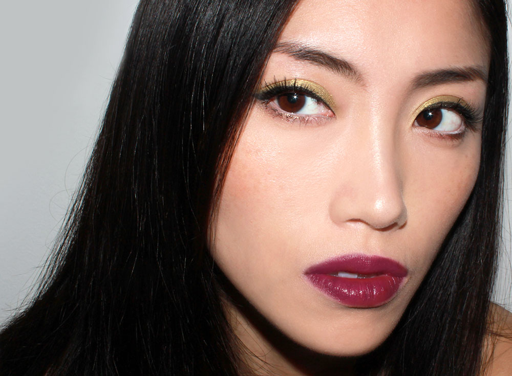 Olive eyeshadow and burgundy lipstick fall makeup look