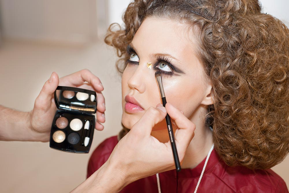 Model getting her makeup done backstage at Chanel Resort 2015