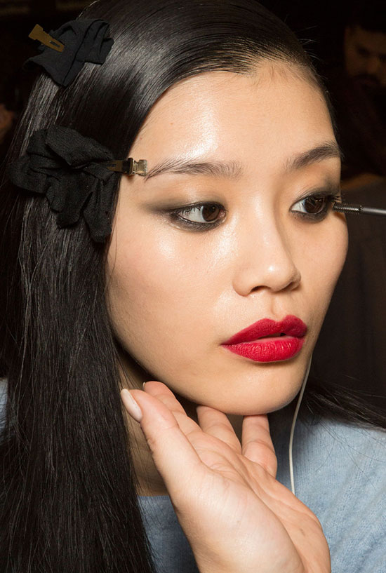 Red lip backstage at Monique Lhuillier A/W 2015